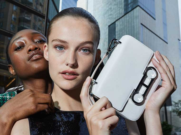 ch carolina herrera model holding insignia white bag in new york
